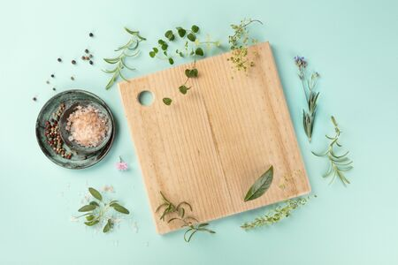 Recipe Design Template. Cutting board with herbs, salt, and pepper, shot from the top Stock Photo
