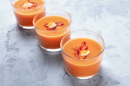 Salmorejo, Spanish chilled tomato and bread soup, served in glasses, with a place for text