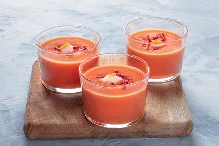 Salmorejo, Spanish chilled tomato and bread soup, served in glasses, with copyspace