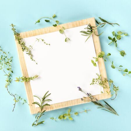 The herbs of Provence, a French recipe design template. A clipboard with aromatic kitchen herbs, shot from the top on a teal background with copy space