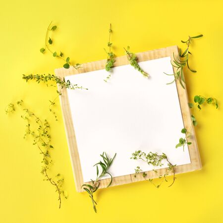 French Cooking Design Template. A clipboard with the herbs of Provence, shot from above on a yellow background with copy space