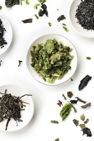Various dry seaweed, sea vegetables, shot from above on a white background