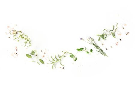 Culinary aromatic herbs on a white background, a flat lay composition with a place for text, a cooking design template