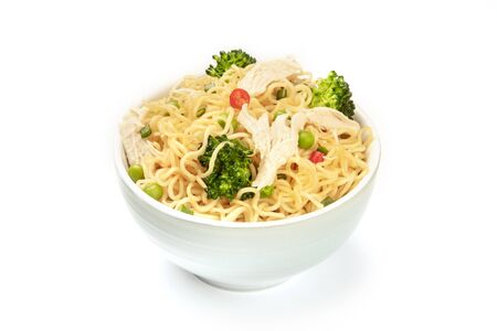 A bowl of soba noodles with vegetables and chicken meat on a white background