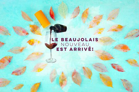Beaujolais Nouveau poster design. The new wine has arrived. With watercolor glass and bottle, autumn leaves and typography.
