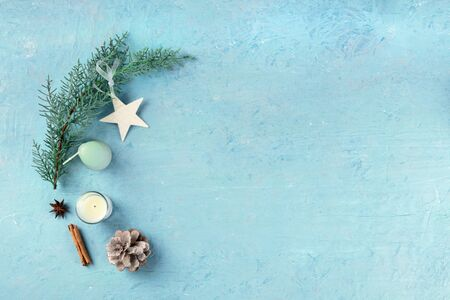 Christmas background, flat lay composition, shot from above on a blue background with copy space, New Year decorations Reklamní fotografie