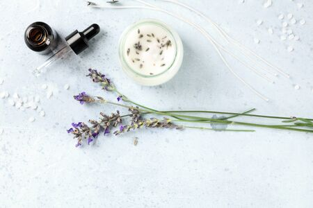 Handmade lavender scented candle with essential oil, flowers, wax and wicks, flat lay, shot from the top with a place for text. An artisanal Christmas gift Reklamní fotografie