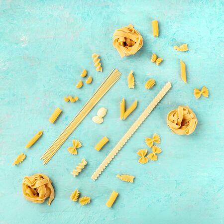Italian pasta of various types, a square flatlay banner, shot from the top on a teal blue background with copyspace