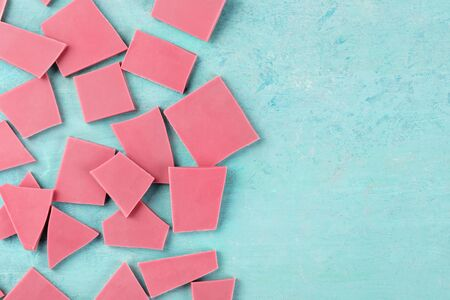 Ruby chocolate, shot from the top on a blue background with a place for text