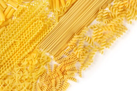 Italian pasta texture, flat lay banner, shot from above on a white background with a place for text. Fusilli, farfalle, penne, spaghetti and other types 写真素材