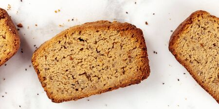 A close-up panorama of a chia seeds cake, shot from the top on a marble cutting board, healthy vegan baking 写真素材