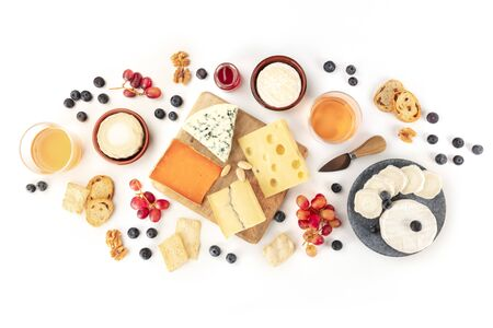 Cheese and wine, tasting and pairing, an overhead flat lay shot on a white background Zdjęcie Seryjne
