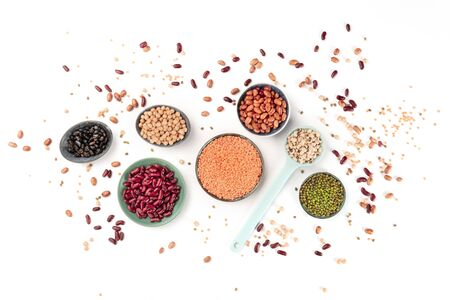 Legumes, top shot on a white background. Vibrant pulses including colorful beans, lentils, chickpeas, a flat lay composition