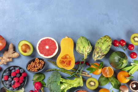 Vegan food. Healthy diet concept. Fruits, vegetables, nuts, mushrooms, shot from the top. A flat lay composition with a place for text Stok Fotoğraf