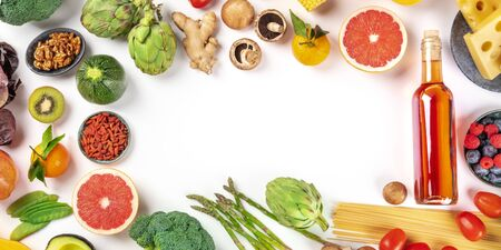 Food panorama with copy space, a flat lay of fruits, vegetables, nuts, wine, and cheese, pasta and mushrooms, forming a frame. A design template for a menu or grocery shop