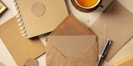 A panorama of brown kraft papers, with an envelope, a notebook, a greeting card, a label Foto de archivo