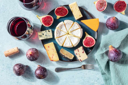 Cheese and wine tasting, cheese platter with figs, a flat lay