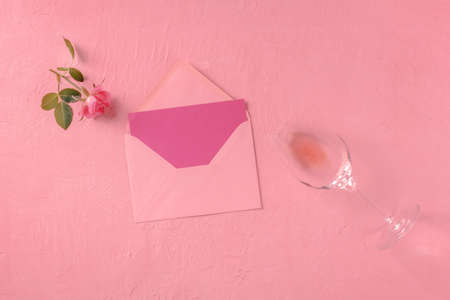 Greeting card, Valentine or invitation mockup, a flatlay with a pink rose and wine, overhead flat lay shot