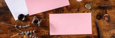 Panorama with a pink card, a mock-up for an invitation or greeting card, overhead flat lay shot