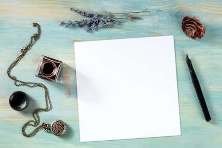 Square mockup with a blank white card, shot from the top with ink and lavender