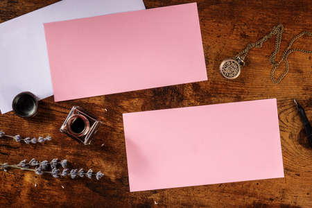 Pink stationery mockup for invitations or greeting cards, overhead flat lay shot