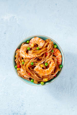 Spicy noodles with shrimps, top shot Reklamní fotografie