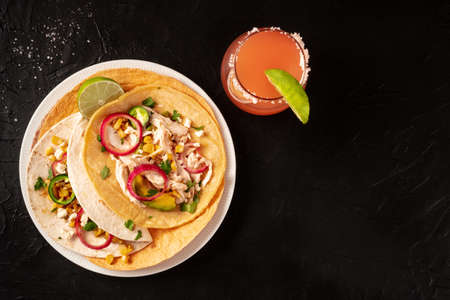 Tacos with chicken and avocado, with a Paloma cocktail
