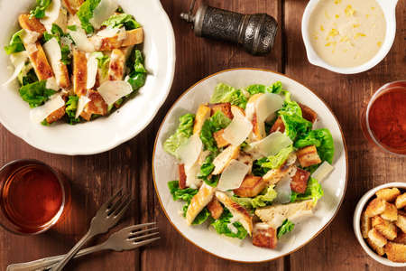 Caesar salad, top shot with wine, pepper, and the classic sauce