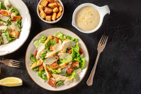 Chicken Caesar salad, shot from above with croutons and the classic dressing