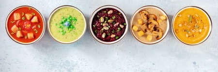 Vegan soup panoramic banner with a place for text. Many vegetable cream soups Banco de Imagens
