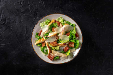 Caesar salad with chicken and Parmesan, shot from above Banco de Imagens