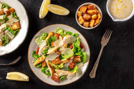 Caesar salad with grilled chicken, romaine and Parmesan