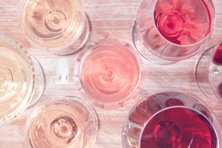 Wine, white, rose, and red, in various glasses, shot from the top 版權商用圖片