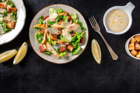 Caesar salad with grilled chicken, romaine and Parmesan cheese 版權商用圖片