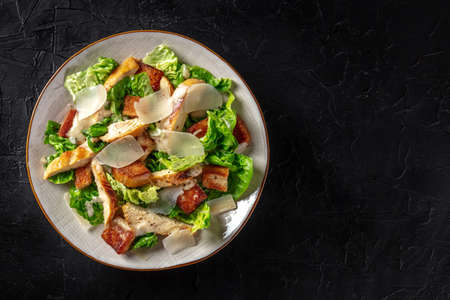 Caesar salad with chicken, shot from above with copy space