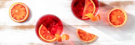 Orange cocktails panorama with blood oranges, top shot