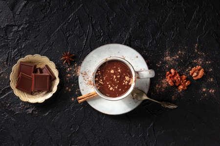 Hot chocolate with cinnamon, overhead flat lay shot