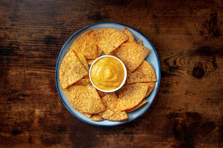 Nacho chips with a cheese dip, overhead shot