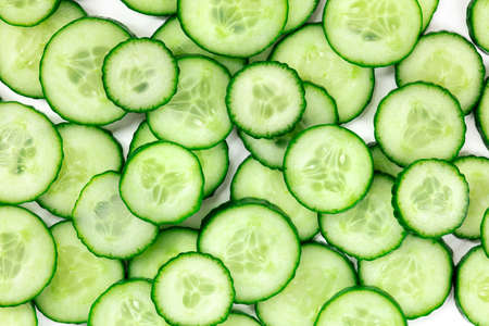 Cucumber background, overhead flat lay shot of cucumber slices