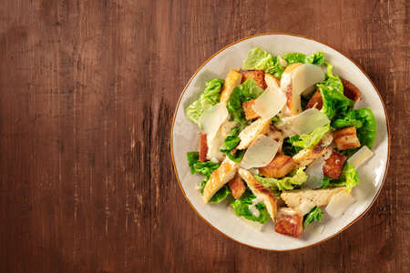 Caesar salad with chicken, top shot with a place for text 写真素材