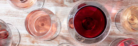 Wine panorama. Glasses of rose, red, and white wine, top shot