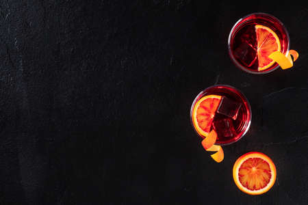 Negroni cocktails with blood oranges and copy space