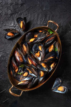 Boiled mussels, shot from above in a pan