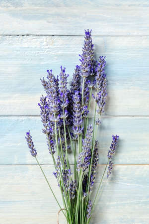 Lavender flower bouquet, shot from the top on a rustic wooden background