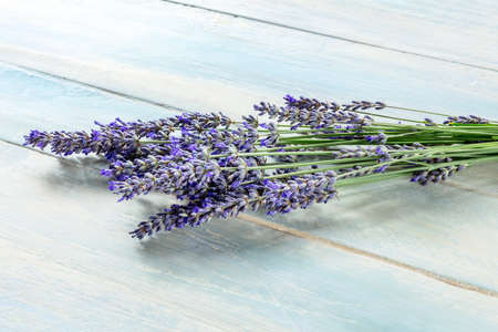Lavender flower bouquet on a rustic wooden background, a bunch of lavandula plants