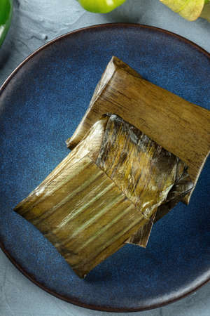 Tamal, traditional dish of Mexican cuisine, various stuffings wrapped in green leaves. Hispanic food, shot from the top 版權商用圖片