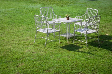 White garden furniture on green grass photo