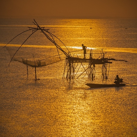 Life asian fisherman and bamboo machinery  square dip net at canal  Klongyoun canal, Pattalung, Thailand  photo