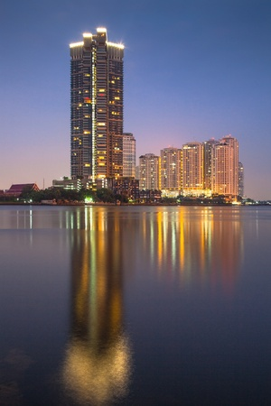 High-rise apartment buildings by the Chao Praya river in Bangkok, Thailand Stock Photo - 18340346