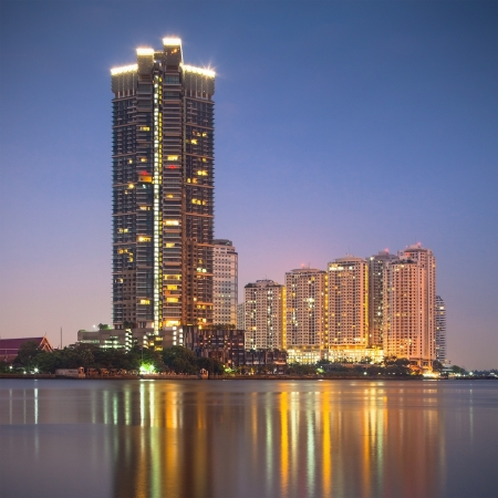 High-rise apartment buildings by the Chao Praya river in Bangkok, Thailand  photo
